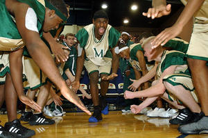 """LeBron James and his teammates from St. Vincent-St. Mary's High School in """"More Than A Game."""""""