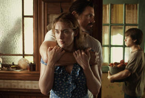 "Kate Winslet as Adele, Josh Brolin as Frank and Gattlin Griffith as Henry in ""Labor Day."""