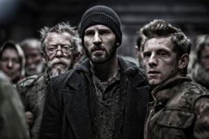 "John Hurt as Gilliam, Chris Evans as Curtis and Jamie Bell as Edgar in ""Snowpiercer."""