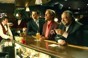 "John Malkovich, Colin Hanks and Ricky Jay in ""The Great Buck Howard."""