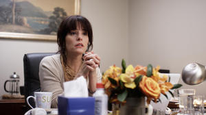"Parker Posey as Susan Felders in ""Price Check."""