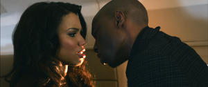 "Jurnee Smollett as Judith and Robbie Jones as Harley in ""Tyler Perry's Temptation: Confessions of a Marriage Counselor."""