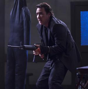 "John Cusack as Jack in ""The Bag Man."""