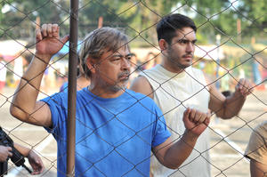 """Joel Torre and Gerald Anderson in """"On the Job."""""""