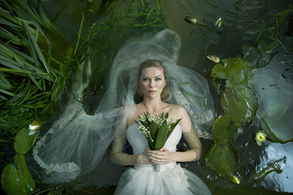 Melancholia Photos + Posters